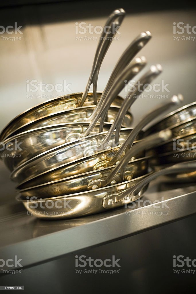 Pans stacked in a commercial restaurant. royalty-free stock photo
