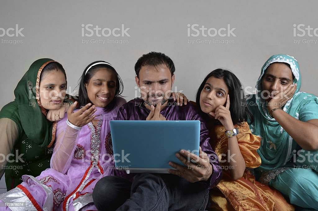 Pansive  Indian Family Using Laptop royalty-free stock photo