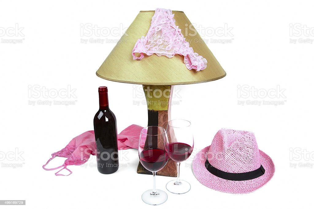 panties on the lamp, bottle of wine and two glasses stock photo