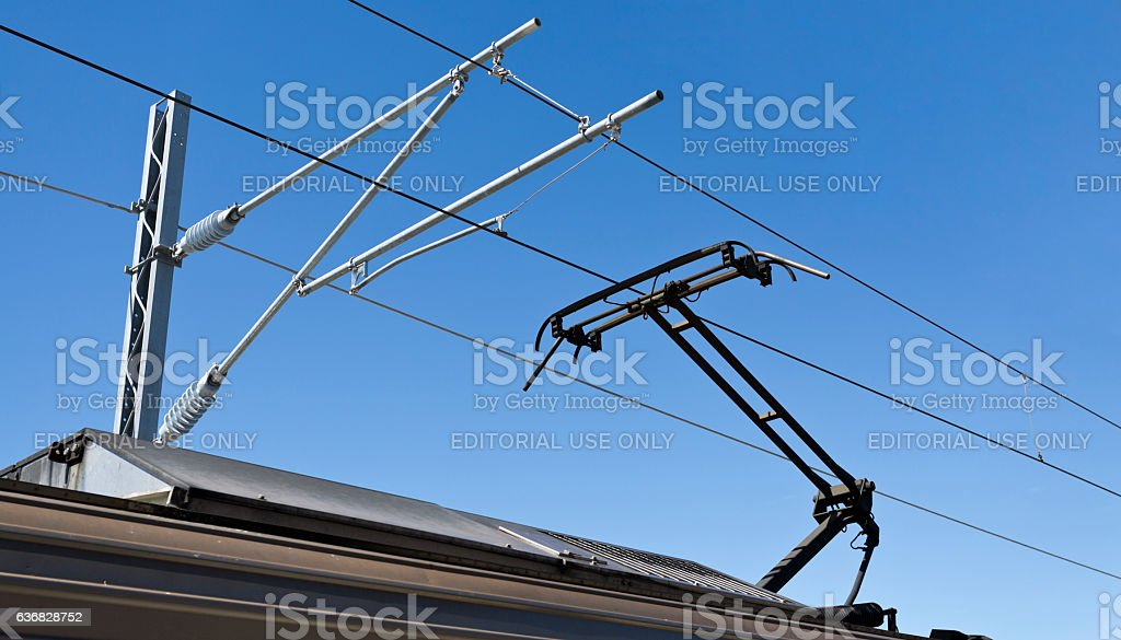 Pantograph and Catenary Wire stock photo
