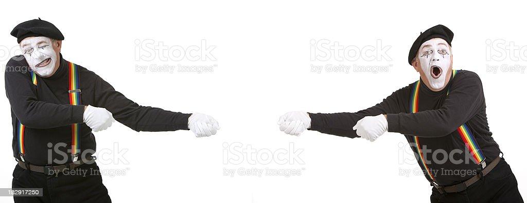 Pantomime playing tug of war stock photo