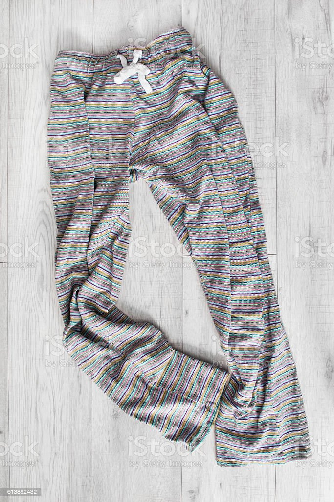 Pants on wooden background stock photo