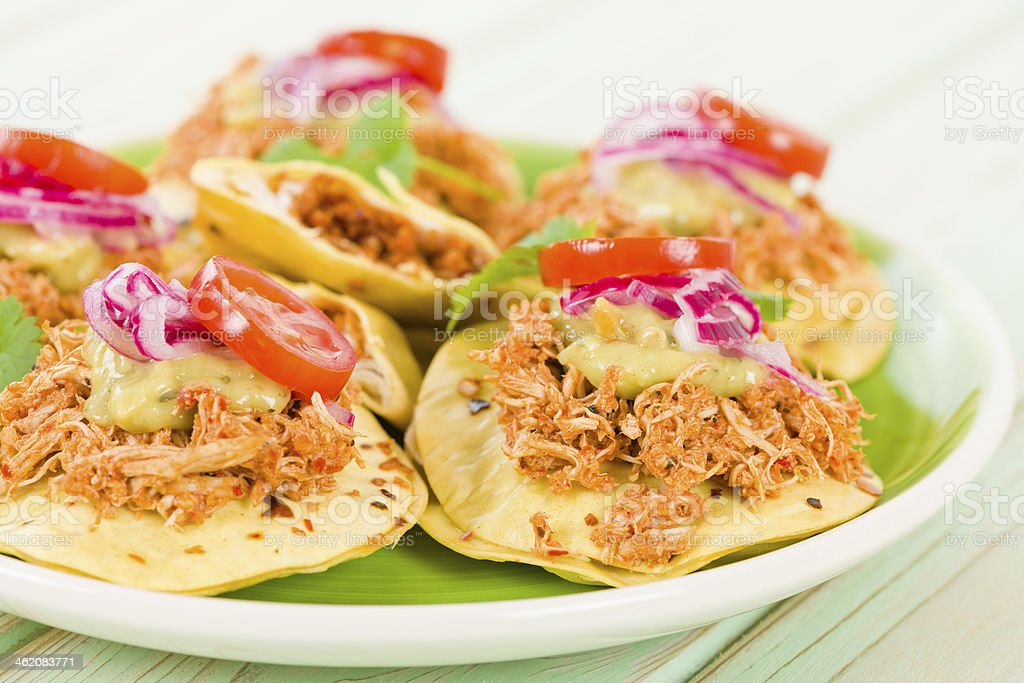 Panuchos arranged on a plate on a table stock photo