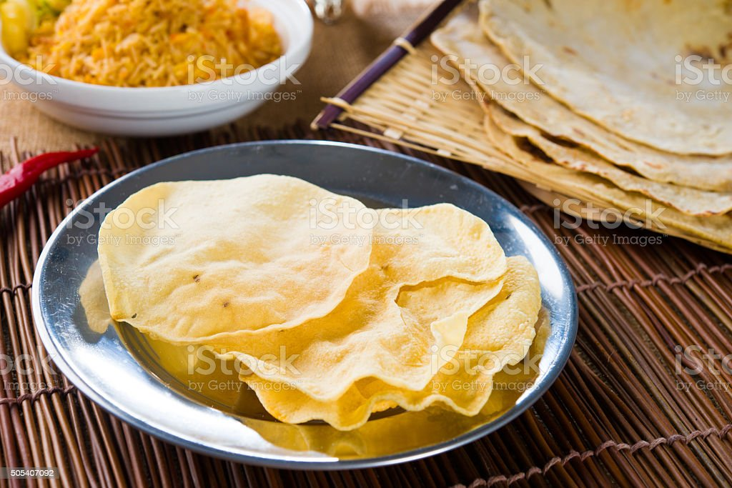 papad or pappadam , indian traditional food stock photo