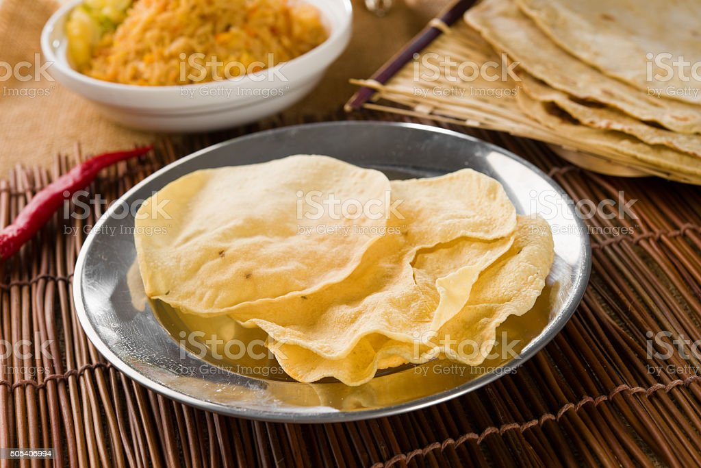 Papadum or papad with various traditional india foods stock photo