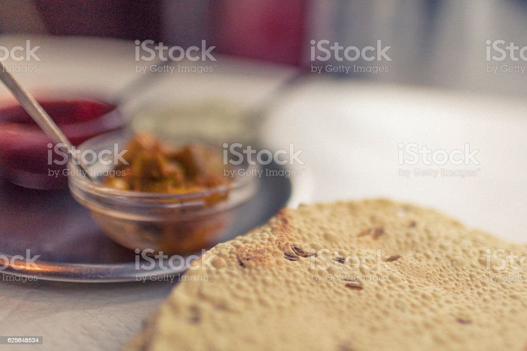 Papadums with Indian condiments stock photo