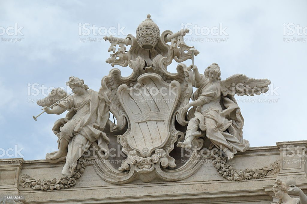 Papal Coat of Arms on Palazzo Poli Facade in Rome stock photo