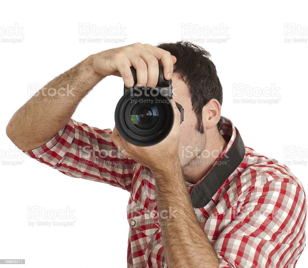 Paparazzi, photographer at work, isolated on white royalty-free stock photo