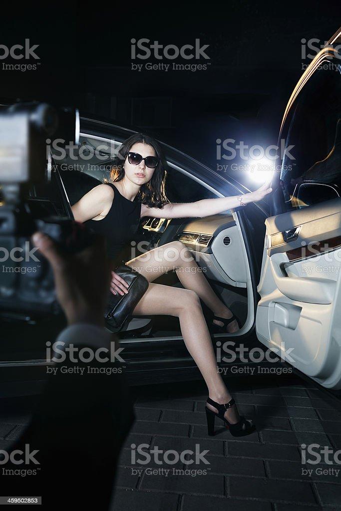 Paparazzi photographer taking photo of woman stock photo