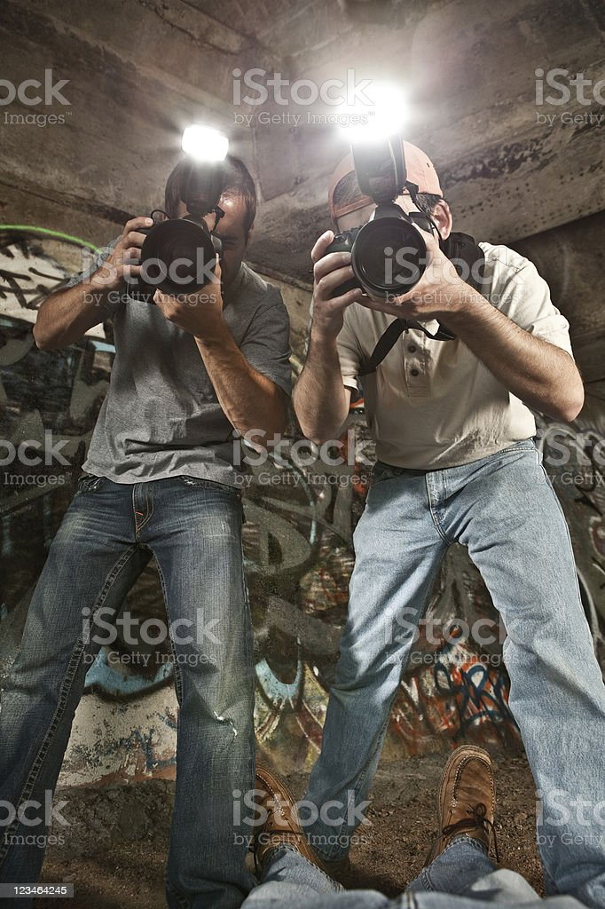 Paparazzi Photographers Shooting a Murder Victim stock photo