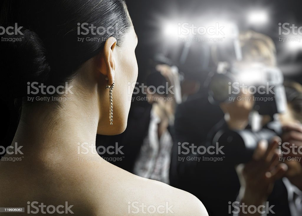 Paparazzi photographing a woman stock photo