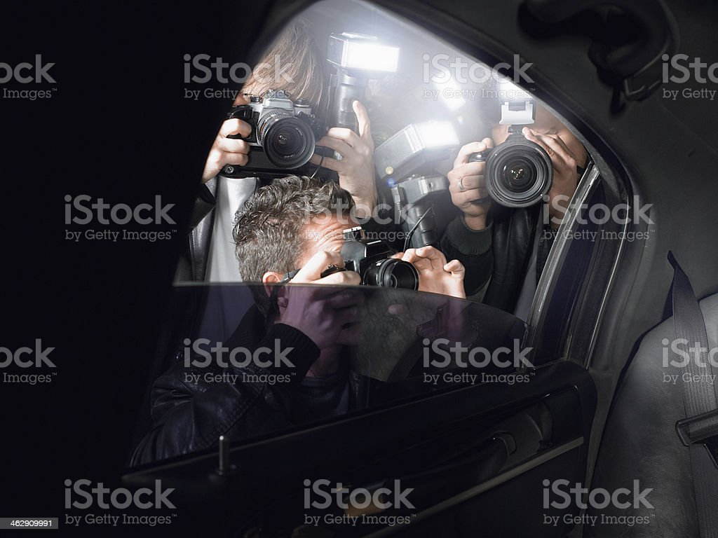 Paparazzi Shooting Through Car Window stock photo