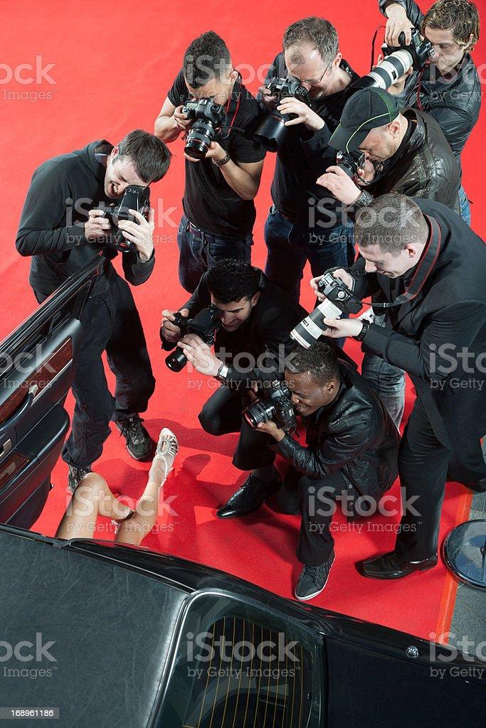 Paparazzi taking photos of celebrity's car stock photo