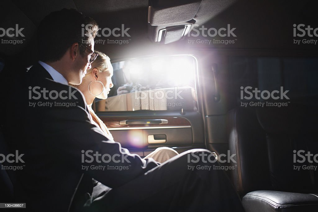 Paparazzi taking picture of celebrities in limo stock photo
