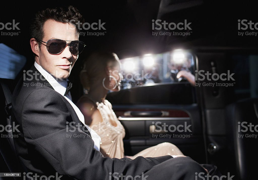 Paparazzi taking pictures of celebrities in limo stock photo