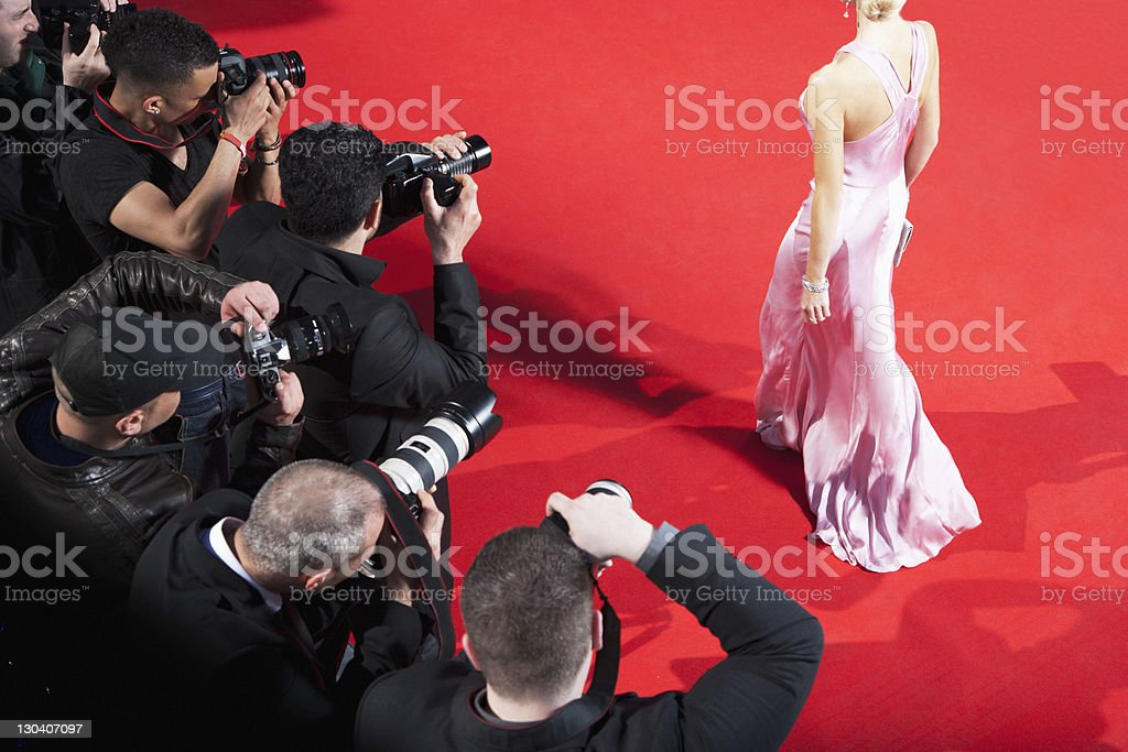 Paparazzi taking pictures of celebrity on red carpet stock photo