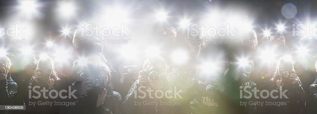 Paparazzi taking pictures with flash stock photo