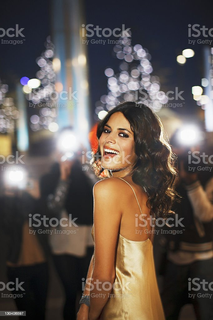 Paparazzi taking smiling celebrity's picture stock photo