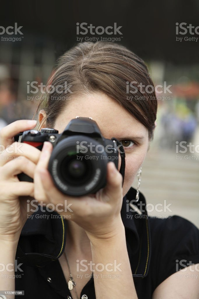 Paparazzi woman taking a picture stock photo