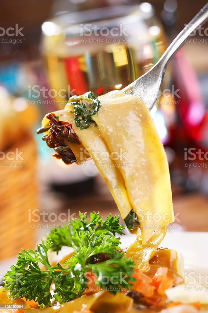 Papardelle with fresh spinach and sundries tomatoes stock photo