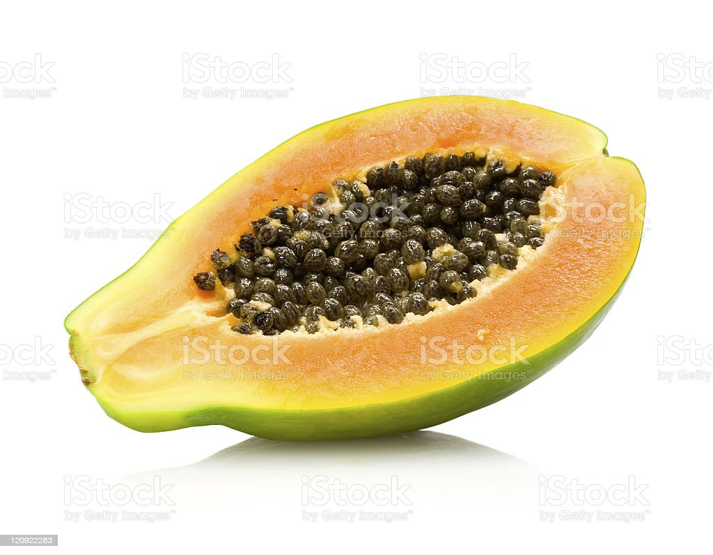 Papaya fruit cut in half and leaning on its side stock photo