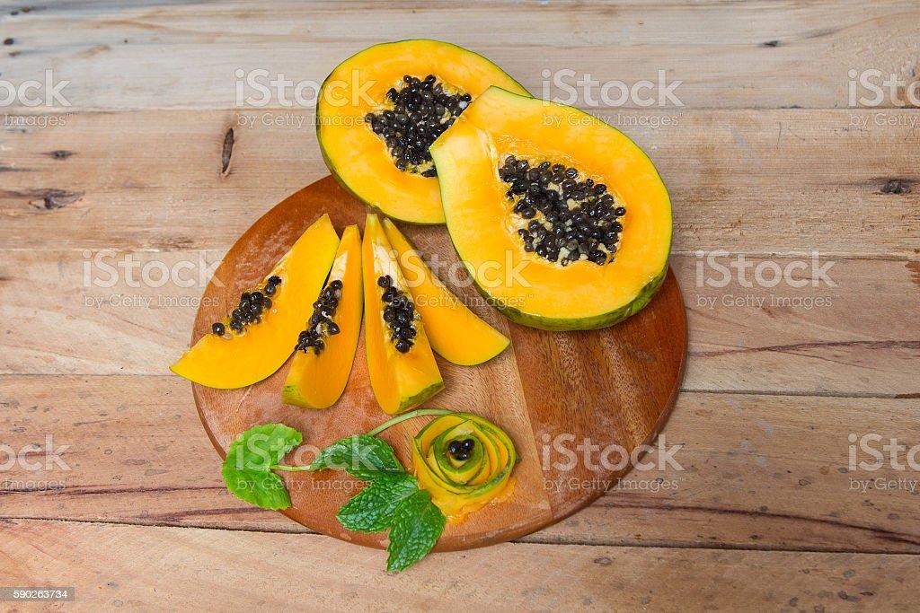 Papaya fruit on wooden background.Sliced fresh papaya. stock photo