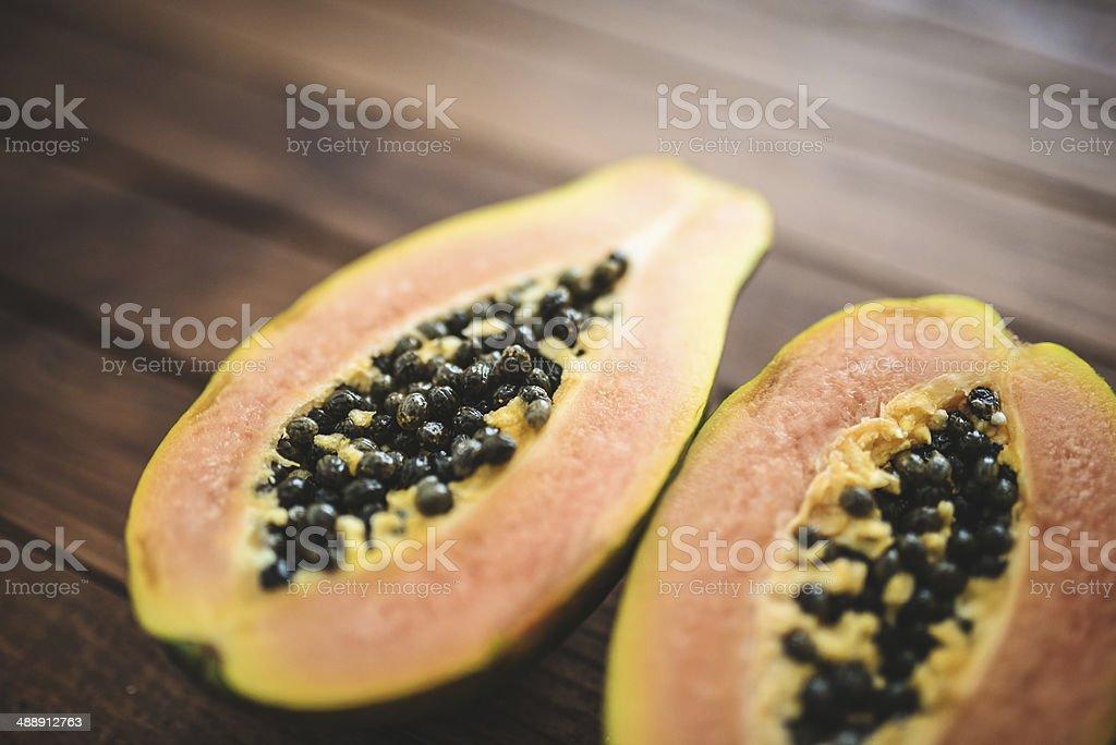 papaya on vintage plank wood stock photo