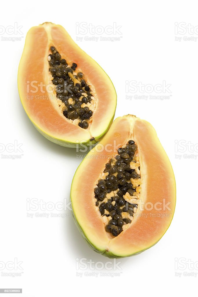 Papaya or paw-paw on a white studio background. royalty-free stock photo