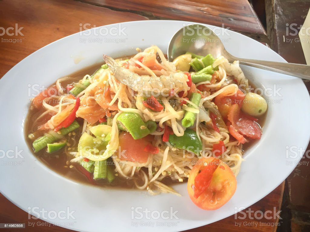 Papaya salad a Thai dish spicy seafood with mix vegetable. stock photo