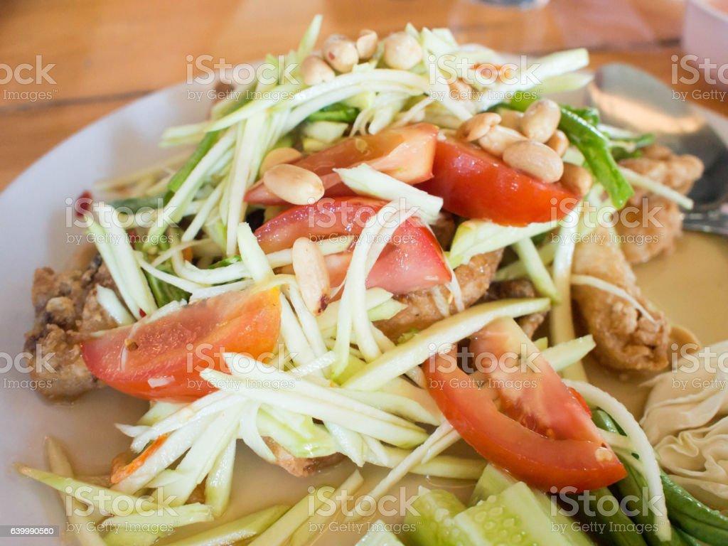 Papaya Salad (Som Tum Thai) on table, popular Thai food. stock photo