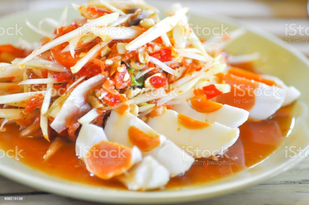 papaya salad or Thai spicy salad (som tam) stock photo
