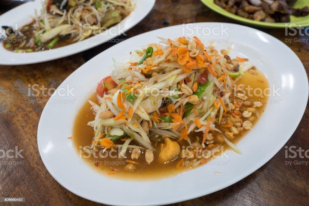 Papaya Salad Thai Style with Satled Eggs on dish stock photo
