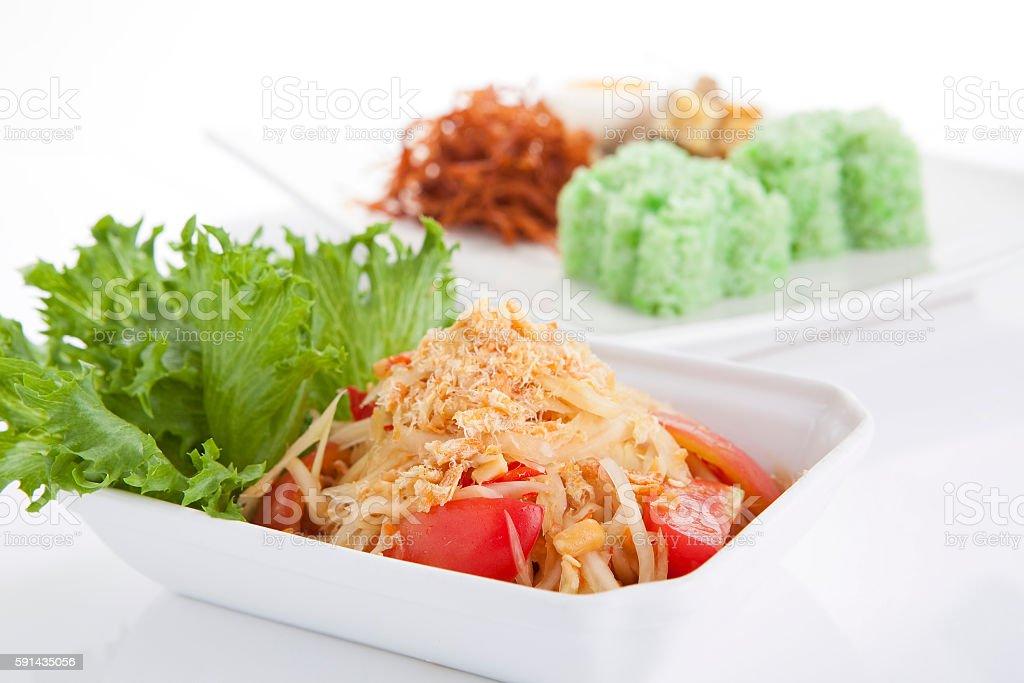 Papaya salad with green sticky rice on background stock photo