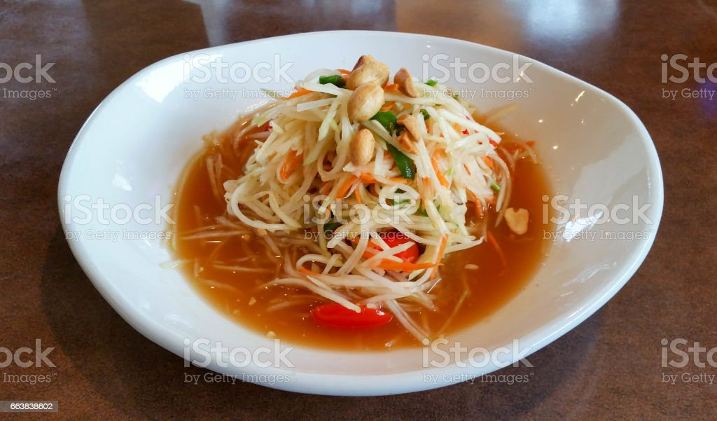 Papaya Salad with peanuts and fish sauce stock photo