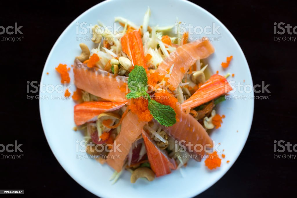 Papaya Salad with Salmon and crab sticks stock photo