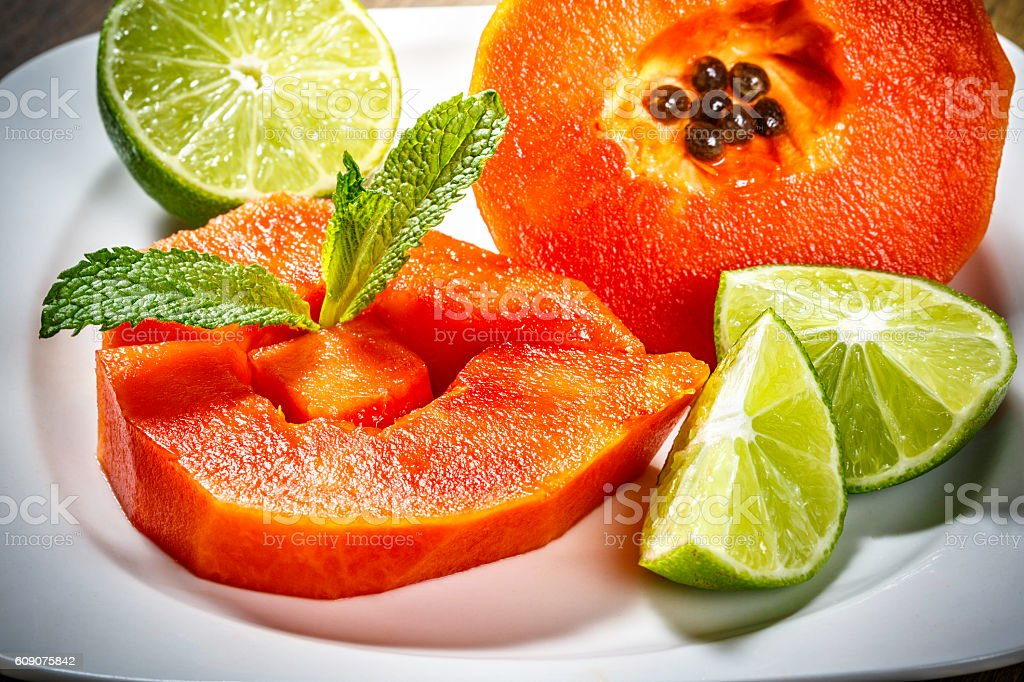 Papaya slices dessert on plate, Fruits for Healthy Eating. stock photo