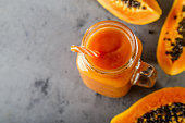 Papaya smoothie, selective focus. Detox, diet food.