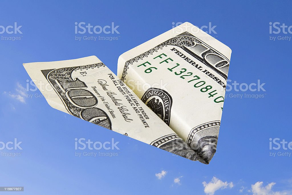 paper airplain made from the 100 dollars banknote royalty-free stock photo