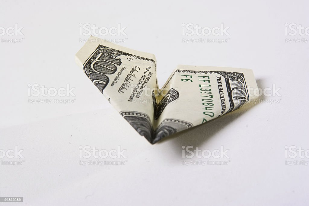 paper airplain made from the 100 dollars royalty-free stock photo