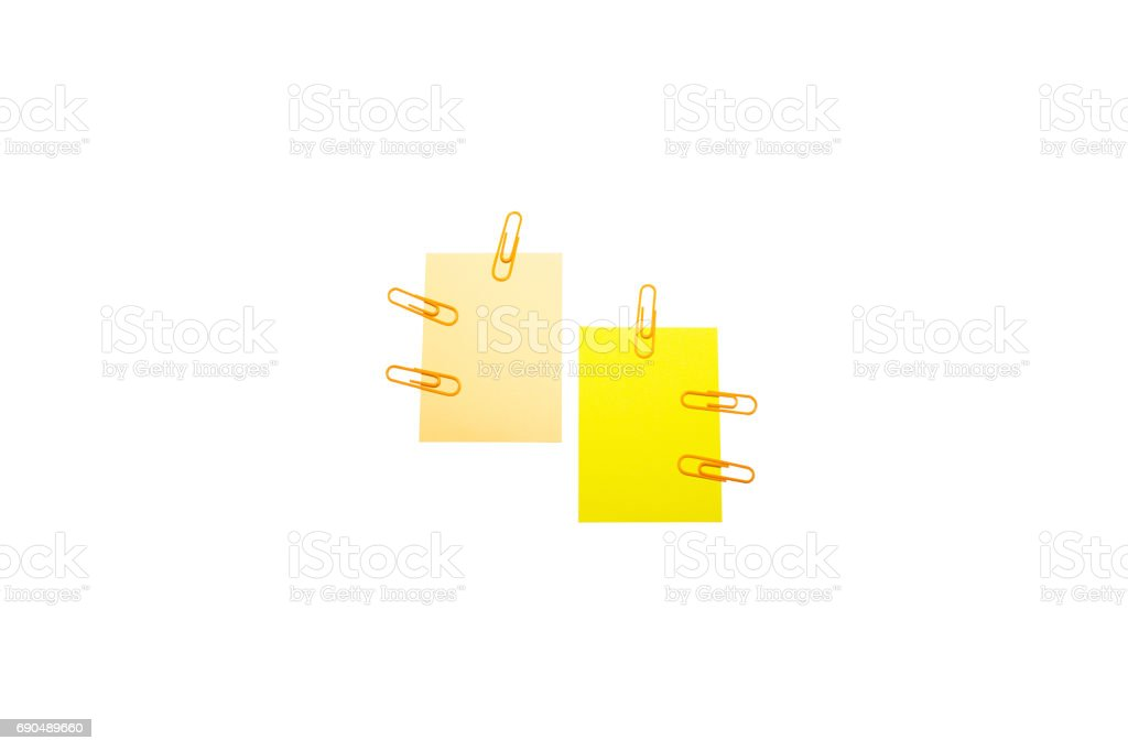 Paper and clip on white background stock photo