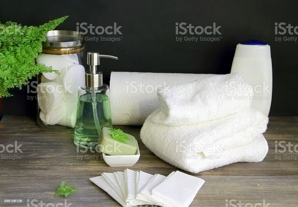 Paper and cotton napkins, tissue, towels, cotton pads, soap, cosmetic products stock photo