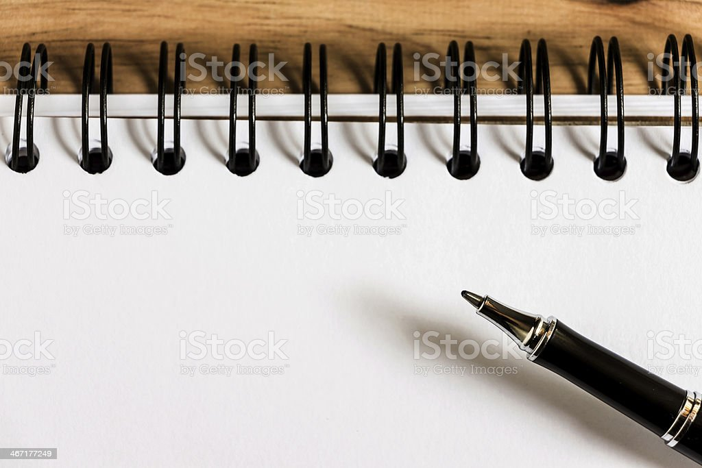 paper and pen on wood texture background with copy space royalty-free stock photo
