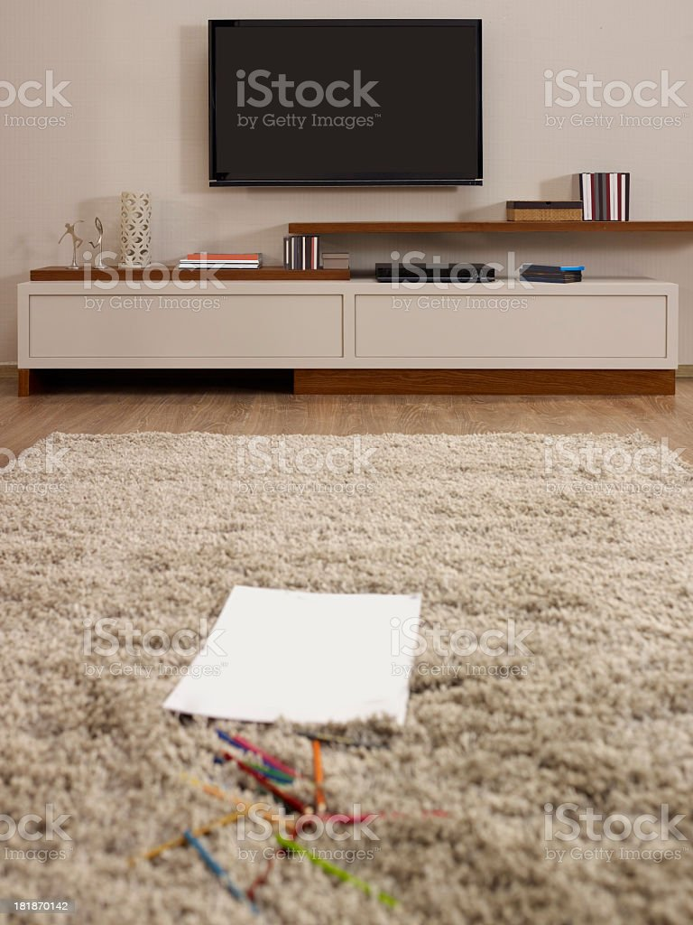 Paper and pencils on rug of modern living room royalty-free stock photo