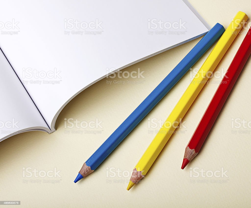 Paper and pencils on the table stock photo