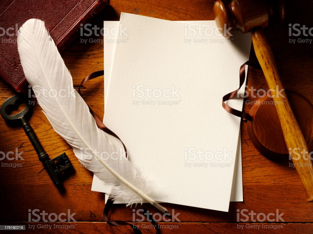 Paper and Quill Pen on a Court Room Table royalty-free stock photo