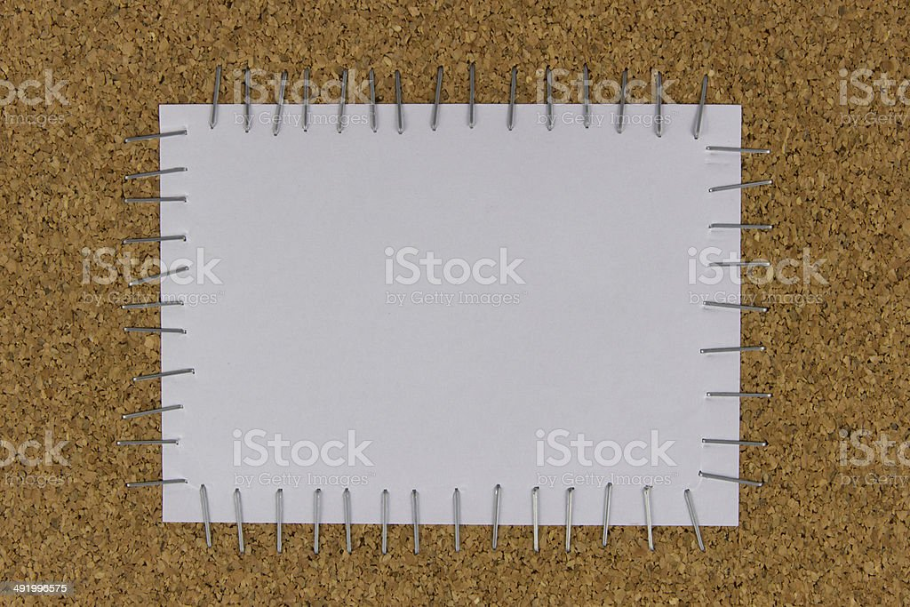 paper attached on the brown board by stapler stock photo