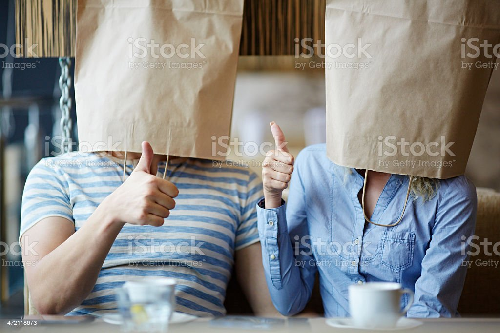 Paper bag couple stock photo