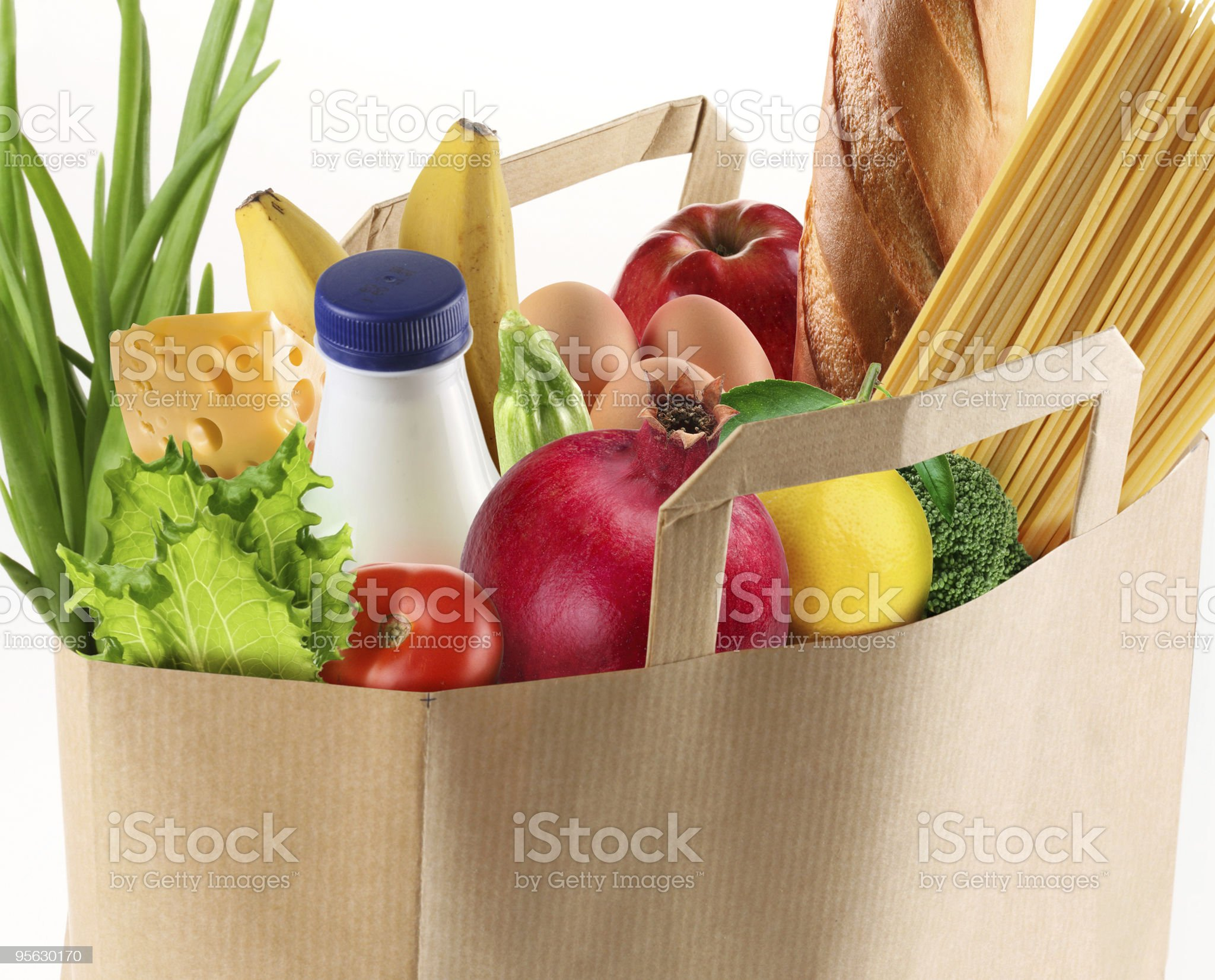 Paper bag filled with fruits vegetables pasta bread and milk royalty-free stock photo