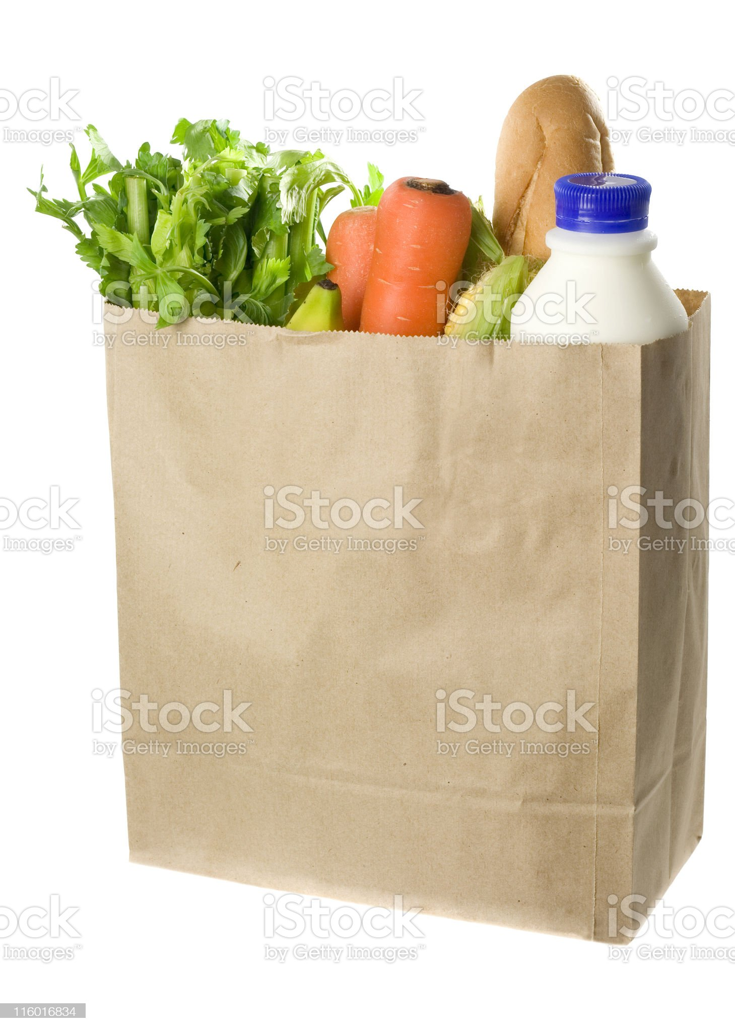 A paper bag full of fresh groceries royalty-free stock photo