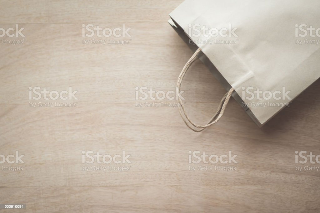 Paper bag on a wooden background stock photo